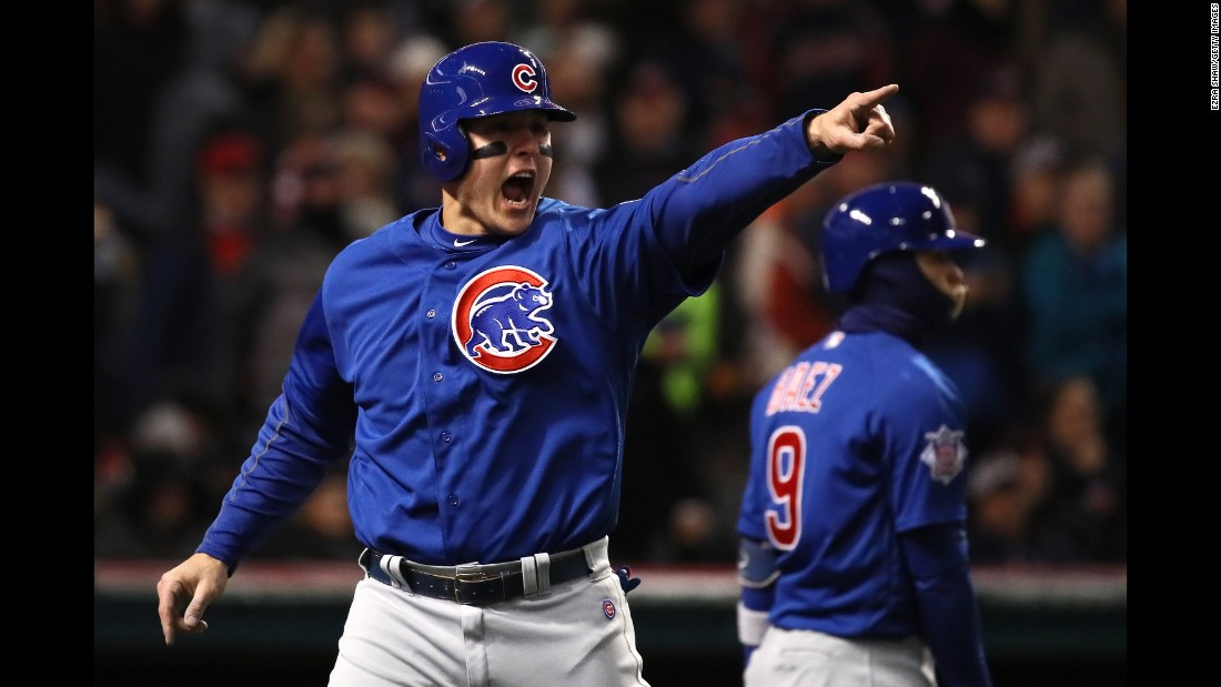 Anthony Rizzo of the Cubs celebrates scoring a run on an RBI single hit by Kyle Schwarber (not pictured) during the third inning in Game 2.