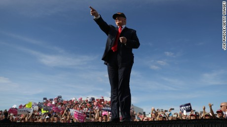 Republican presidential candidate Donald Trump arrives on stage during a campaign rally at the Million Air Orlando, which is at Orlando Sanford International Airport on October 25, 2016 in Sanford, Florida. Trump continues to campaign against his Democratic challenger Hillary Clinton as election day nears.