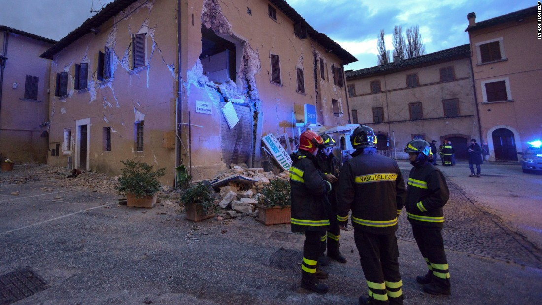 Firefighters inspect damage in Visso on October 27.
