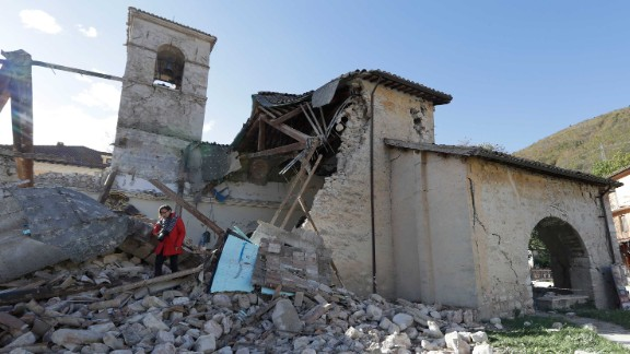 A woman walks among debris at the Church of St. Antony, dating from the 14th century, in the town of Visso on Thursday, October 27, after a pair of earthquakes rocked central Italy. A magnitude 5.5 quake struck Wednesday, October 26, followed hours later by a magnitude 6.1 temblor. No deaths were reported, but historic buildings were damaged in the region where a powerful quake killed nearly 300 people in August.