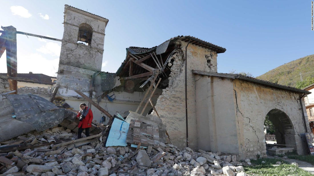 "A woman walks among debris at the Church of St. Antony, dating from the 14th century, in the town of Visso on Thursday, October 27, after a pair of earthquakes rocked central Italy. A magnitude 5.5 quake struck Wednesday, October 26, followed hours later by a magnitude 6.1 temblor. No deaths were reported, but historic buildings were damaged in the region where a powerful <a href=""http://www.cnn.com/2016/08/27/europe/italy-earthquake-amatrice-perugia/"">quake killed nearly 300 people</a> in August."