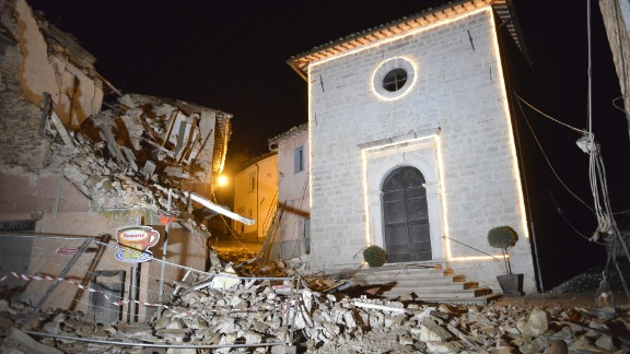 The Church of San Sebastiano stands amid damaged houses in Castelsantangelo sul Nera, Italy, following a pair of strong aftershocks that shook central Italy late Wednesday.