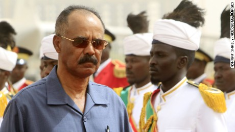 Eritrean President Isaias Afwerki (L) reviews the honor guard during his welcome ceremony in the Sudanese capital, Khartoum, on June 11, 2015.  AFP PHOTO / ASHRAF SHAZLY        (Photo credit should read ASHRAF SHAZLY/AFP/Getty Images)