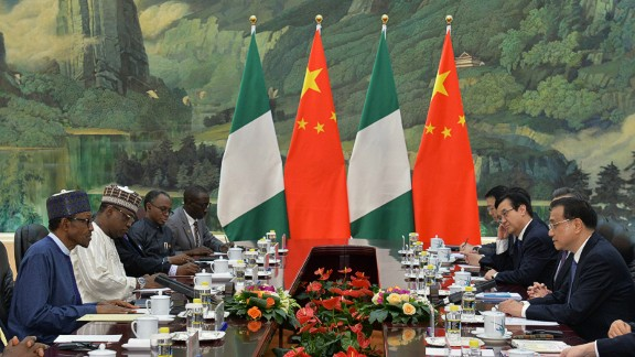 Nigerian President Muhammadu Buhari has dinner with Chinese Premier Li Keqiang in Beijing in April 2016.