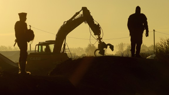 Heavy machinery is used to remove debris from the camp on October 27.