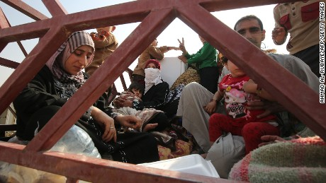 Dozens executed by ISIS as fight for Mosul escalates