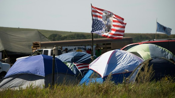 Tents and a flag are seen at an oil pipeline protest encampment near Cannon Ball, North Dakota where members of the Standing Rock Sioux tribe and their supporters have gathered to voice their opposition to the Dakota Access Pipeline (DAPL), September 3, 2016. Drive on a state highway along the Missouri River, amid the rolling hills and wide prairies of North Dakota, and you'll come across a makeshift camp of Native Americans -- united by a common cause. Members of some 200 tribes have gathered here, many raising tribal flags that flap in the unforgiving wind. Some have been here since April, their numbers fluctuating between hundreds and thousands, in an unprecedented show of joint resistance to the nearly 1,200 mile-long Dakota Access oil pipeline.