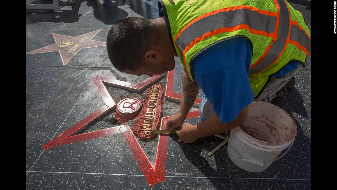 "Workers repair Donald Trump's star on the Hollywood Walk of Fame after <a href=""http://www.cnn.com/2016/10/26/politics/hollywood-star-donald-trump-vandalism/index.html"" target=""_blank"">it was vandalized</a> on Wednesday, October 26."