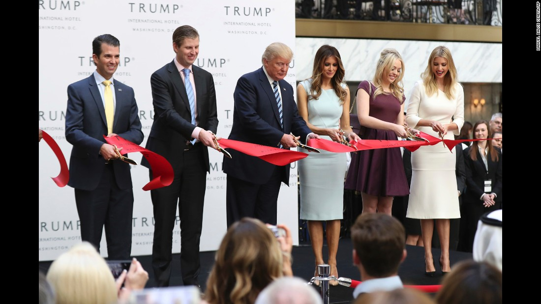 Republican presidential nominee Donald Trump attends a ribbon-cutting ceremony for the Trump International Hotel in Washington on Wednesday, October 26. Joining Trump, from left, are his sons Donald Jr. and Eric; his wife, Melania; and his daughters, Tiffany and Ivanka.