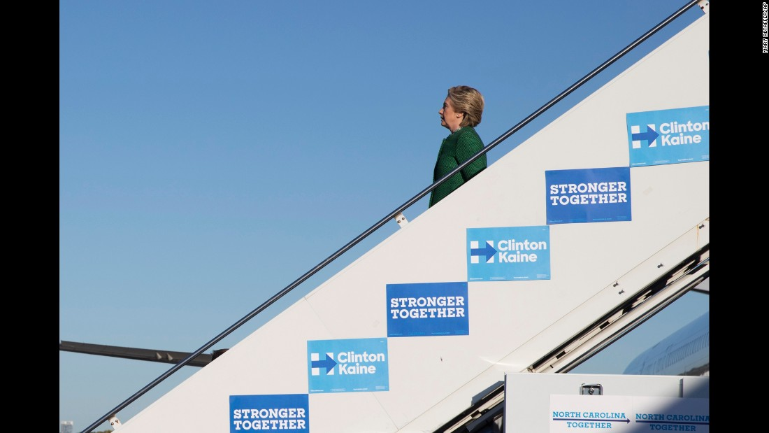Democratic presidential nominee Hillary Clinton steps off her plane in Charlotte, North Carolina, on Sunday, October 23.