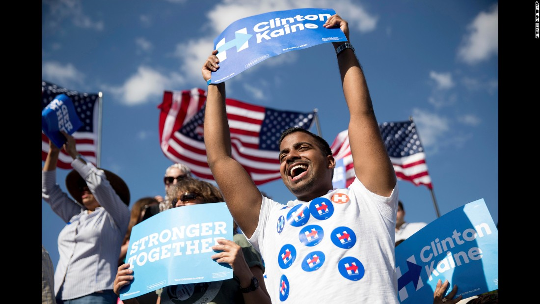 People cheer for Democratic presidential nominee Hillary Clinton as she speaks at a rally in Tampa, Florida, on Wednesday, October 26.