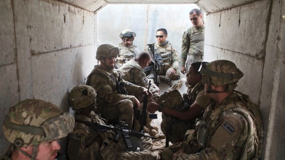 U.S. military personnel take cover in a bunker after a mortar alarm was sounded at a coalition air base in Qayyara on Friday, October 28.