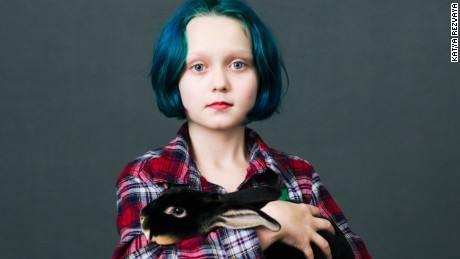 Virginia Anderson (10) from Dallas, Oregon with her bunny Romeo (6 months) of «Black Otter Rex» breed  she just bought at the show. 
