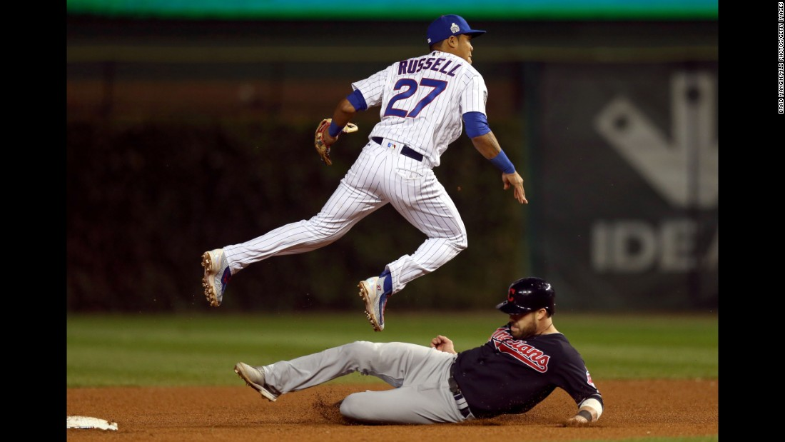 Addison Russell of the Cubs turns an inning-ending double play in the fifth inning in Game 3.