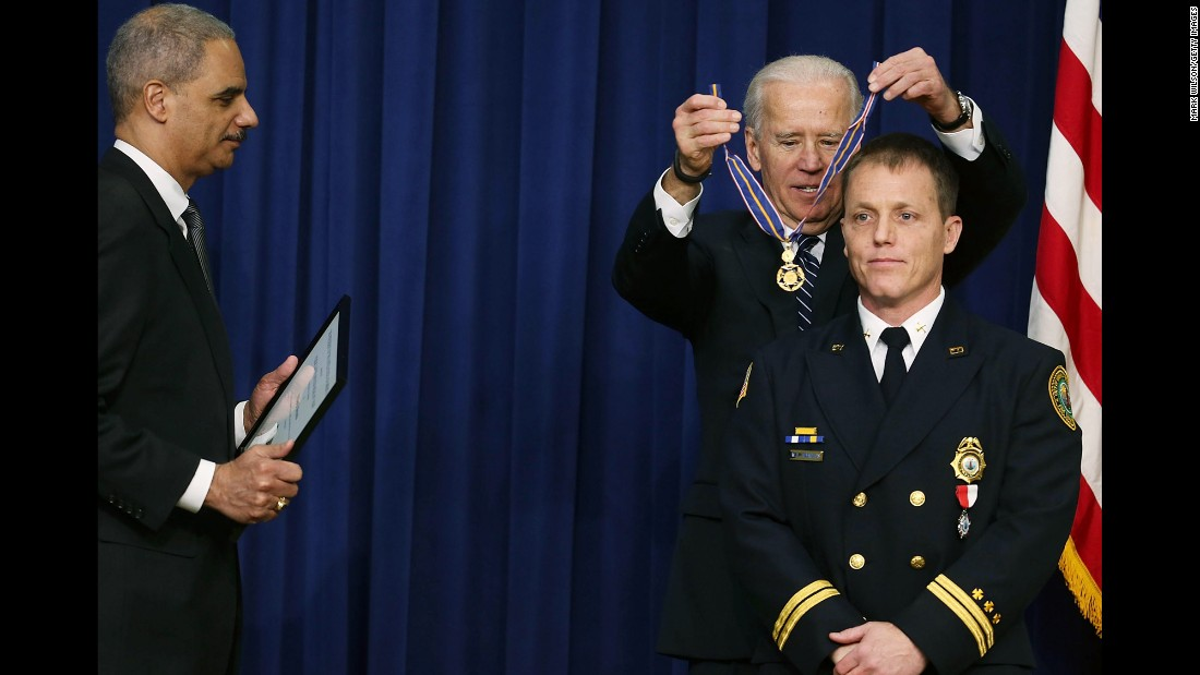 Biden awards the Medal of Valor to William Reynolds, a battalion chief with the Virginia Beach Fire Department, during a ceremony in Washington in February 2013. Biden presented the award to public safety officers who had exhibited exceptional courage, regardless of personal safety, in the attempt to save or protect others from harm.