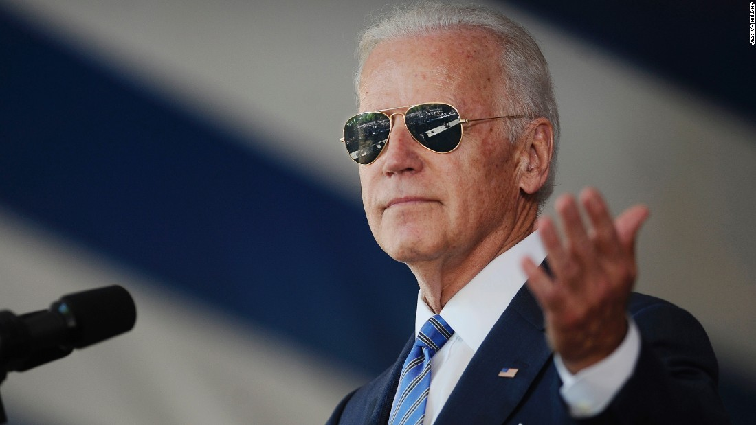 "Biden wears <a href=""http://www.cnn.com/2014/04/16/politics/gallery/joe-biden-on-instagram/index.html"" target=""_blank"">his signature aviator sunglasses</a> as he addresses graduating students at Yale University in May 2015."