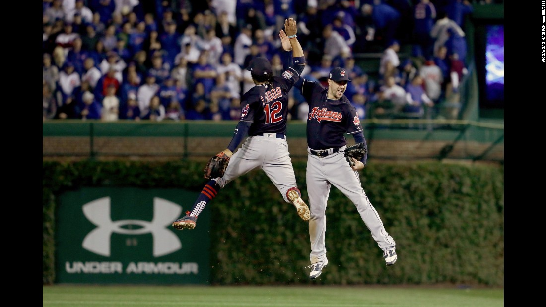 Francisco Lindor and Brandon Guyer of the Indians celebrate after beating the Cubs 1-0 in Game 3.