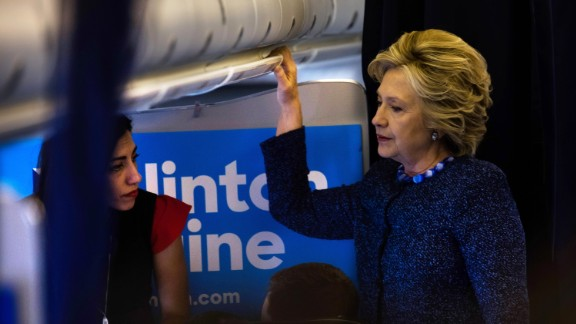 Democratic presidential candidate Hillary Clinton on the plane to Cedar Rapids, Iowa with Huma Abedin. Later in the day Mrs. Clinton had to deal with FBI announcement about further investigation into her emails. October 28, 2016.