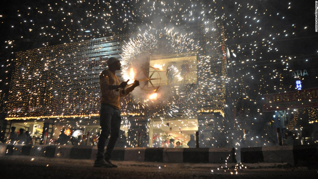 A man joins in a fireworks display at a marketplace in Jammu, India, on the eve of a Diwali festival on Thursday, October 27.