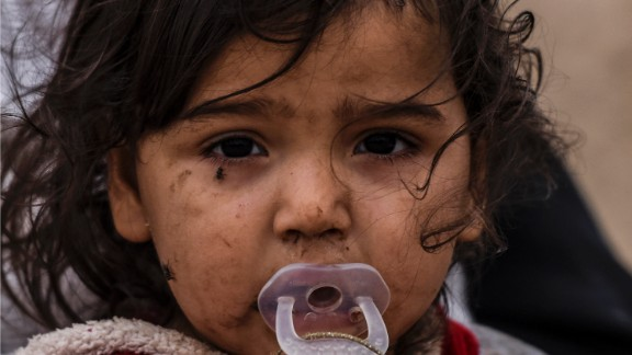 An Iraqi girl who was displaced with her families by the ongoing operation by Iraqi forces against jihadists of the Islamic State group to retake the city of Mosul, is seen in an area near Qayyarah on October 28, 2016.  Jihadists have killed scores of people and taken tens of thousands to use as human shields in the Mosul area, the United Nations said, as Iraqi forces temporarily halted their advance on the city. / AFP / BULENT KILIC        (Photo credit should read BULENT KILIC/AFP/Getty Images)