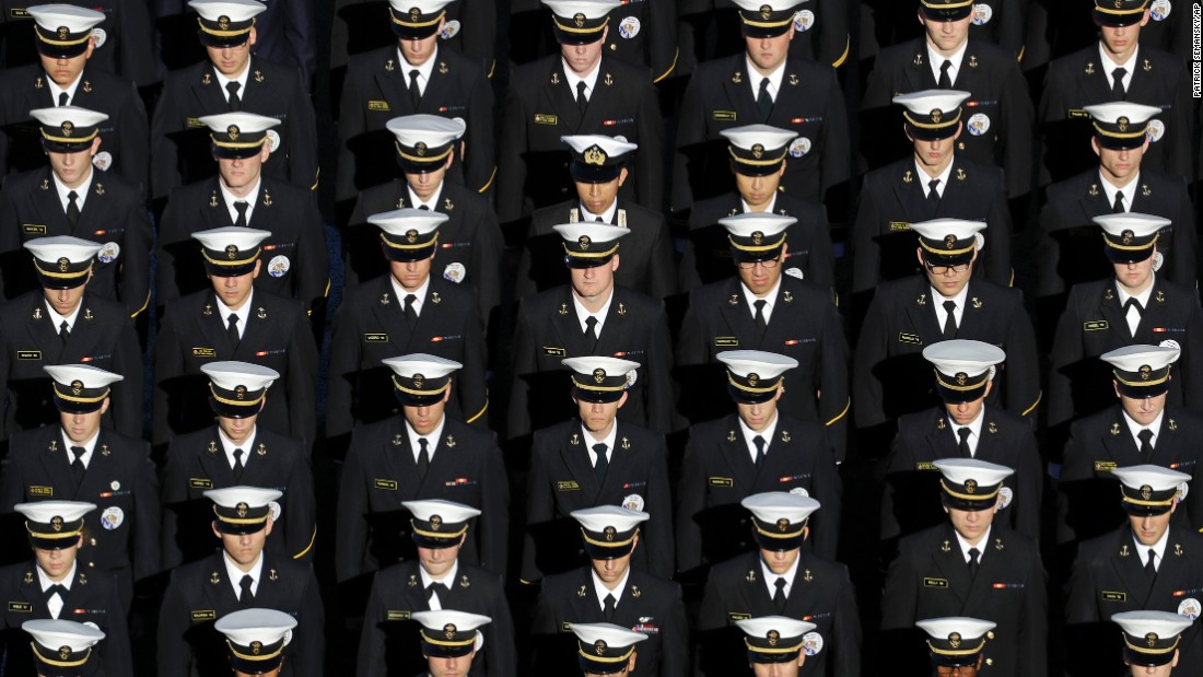 Members of the U.S. Naval Academy stand in formation before a college football game in Annapolis, Maryland, on Saturday, October 22.