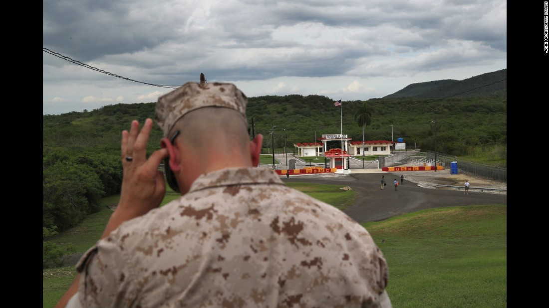 A U.S. Marine overlooks the Northeast Gate at the naval station in Guantanamo Bay, Cuba, on Sunday, October 23.