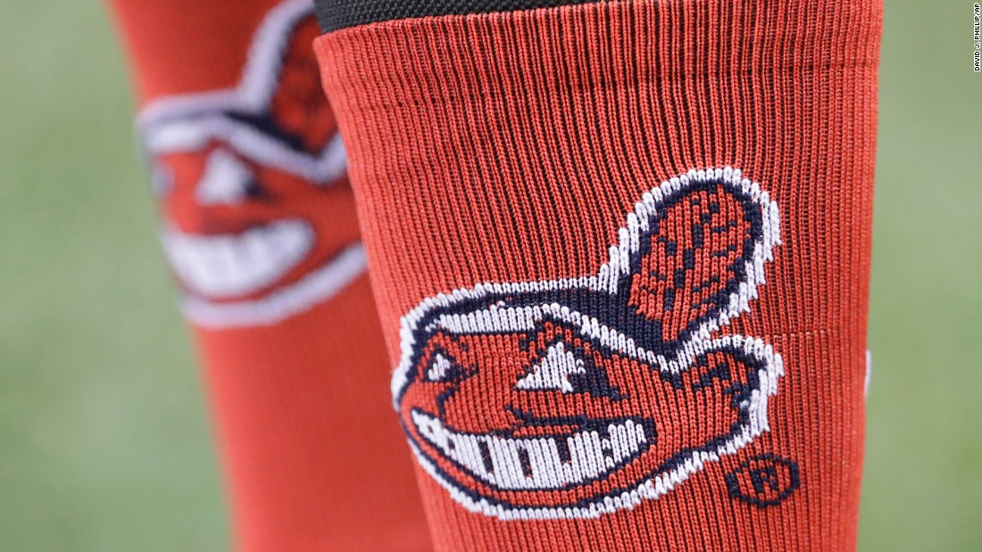 Cleveland Indians' Carlos Santana wears socks with the team logo before Game 4.