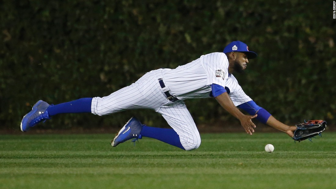 Chicago Cubs center fielder Dexter Fowler can't make the catch on a double hit by Cleveland Indians' Coco Crisp during the seventh inning of Game 4.