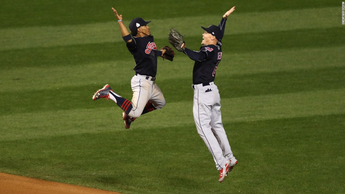 Francisco Lindor, left, and Brandon Guyer, right, of the Cleveland Indians celebrate after beating the Chicago Cubs 7-2 in Game 4 of the 2016 World Series at Wrigley Field on Saturday, October 29, in Chicago.