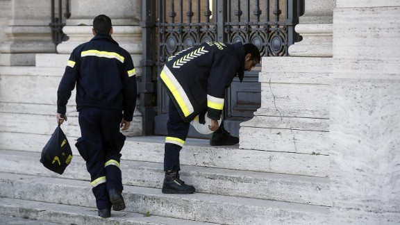 Firefighters from Vatican City check out St. Paul's Basilica in Rome on October 30 following the earthquake. Several buildings in the Italian capital have suffered minor damage from the series of quakes.