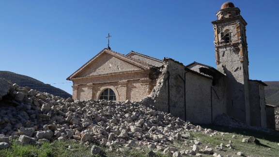 The tower of the Church of the Madonna of the Angels (Madonna degli Angeli) is still standing amidst rubble near Norcia, central Italy, after an earthquake with a preliminary magnitude of 6.6 struck central Italy, Sunday, Oct. 30, 2016. A powerful earthquake rocked the same area of central and southern Italy hit by quake in August and a pair of aftershocks last week, sending already quake-damaged buildings crumbling after a week of temblors that have left thousands homeless. (AP Photo/Gregorio Borgia)