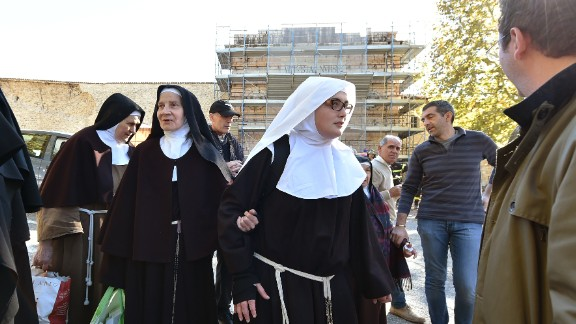 Nuns leave the center of Norcia after being helped out of a church Sunday.
