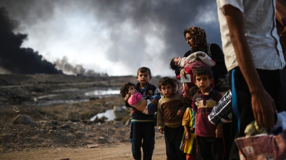 Iraqi families displaced by the ongoing operation to retake the city of Mosul from ISIS are seen near Qayyarah, south of the city, on October 29, 2016.