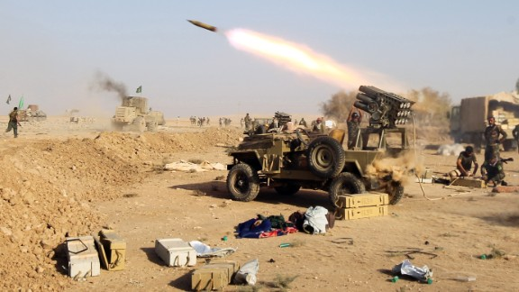 Shiite fighters from the Hashed al-Shaabi launch missiles on the village of Salmani, south of Mosul, on October 30, 2016 during the ongoing battle against Islamic State to liberate the city of Mosul.