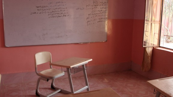 A room in a house in the town of Bazwaya, near Mosul city, was used as an ISIS classroom. The Arabic writing on the whiteboard is a lesson about how to use grenades.
