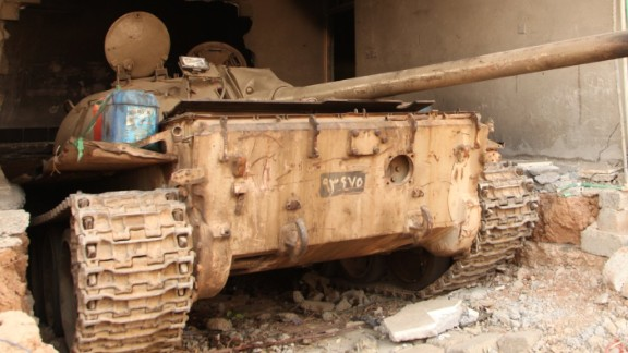 An old soviet era tank hidden in a house in the town of Tabzawa about 4 kilometers away from Mosul city, ISIS cut out the wall of the house and reversed the tank into it to avoid detection by collation forces fighter jets and drones. (Ghazi Balkiz/CNN)