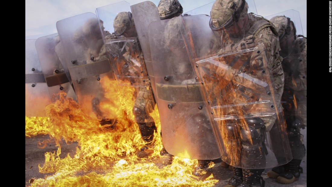 U.S. soldiers maintain a defensive position during fire phobia training in Hohenfels, Germany, on Sunday, October 23.