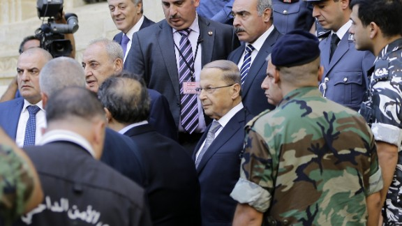Michel Aoun, center wearing glasses, leaves parliament after a voting session Monday in Beirut.
