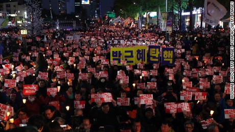 SEOUL, SOUTH KOREA - OCTOBER 29:  Thousands of South Koreans took to the streets in the city center to demand President Park Geun-hye to step down on October 29, 2016 in Seoul, South Korea. The protest stems from allegations that President Park let her friend Choi Soon-Sil interfere in important state affairs. (Photo by Woohae Cho/Getty Images)
