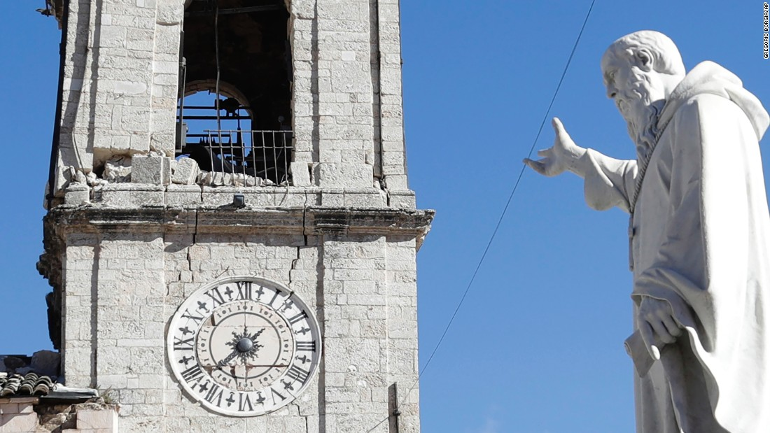 A statue of St. Benedict remains standing in front of the damaged bell tower in the town of Norcia on October 31.