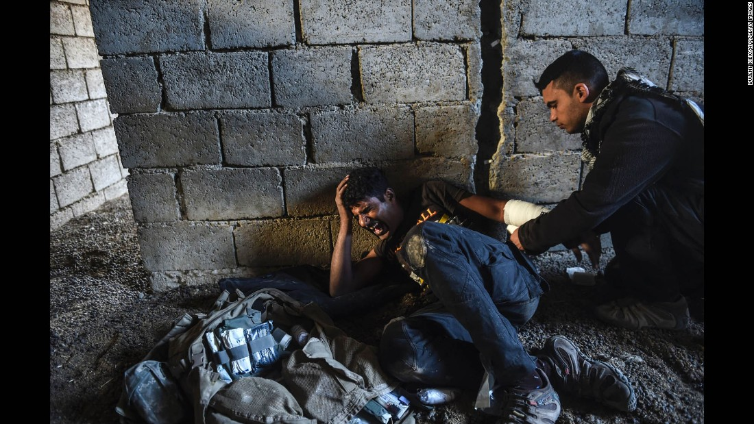 An Iraqi soldier receives treatment after being injured during clashes with ISIS fighters near Bazwaya on October 31.