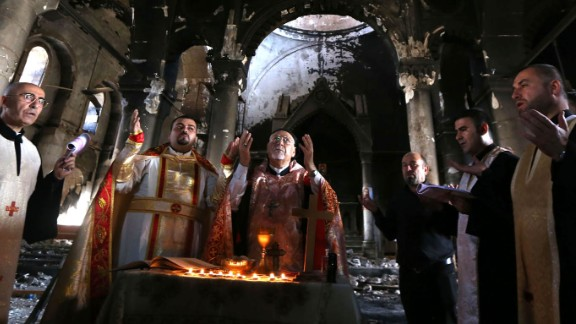 Archbishop Yohanna Petros Mouche, center, performs Mass in the liberated town of Qaraqosh on Sunday, October 30.