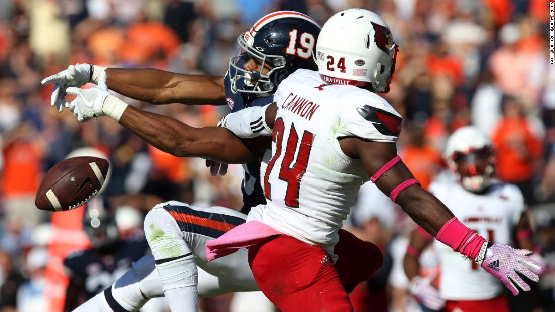 Louisville's Zykiesis Cannon knocks down a pass intended for Virginia's Andre Levrone during a college football game in Charlottesville, Virginia, on Saturday, October 29.