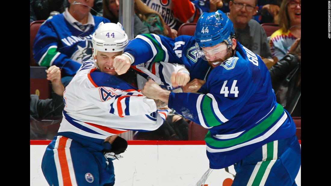Edmonton's Zack Kassian, left, and Vancouver's Erik Gudbranson trade punches during an NHL game in Vancouver, British Columbia, on Friday, October 28.
