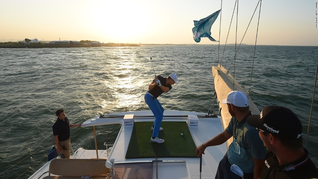 German golfer Alexander Knappe hits a ball off a boat during a promotional event for the Challenge Tour event in Muscat, Oman, on Monday, October 31.