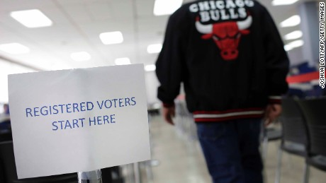 A man walks in the registered voter line during early voting at a polling station inside Truman College on October 31, 2016 in Chicago, Illinois.