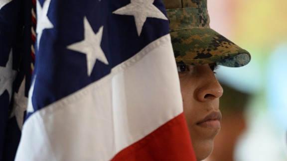 A Marine stands next to the US flag during a ceremony at the US Marines headquarters in Manila, the Philippines, in October 2016.