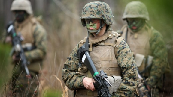 Pfc. Tiernie Gayle, center,  trains with male and female Marines at Camp Lejeune, North Carolina.