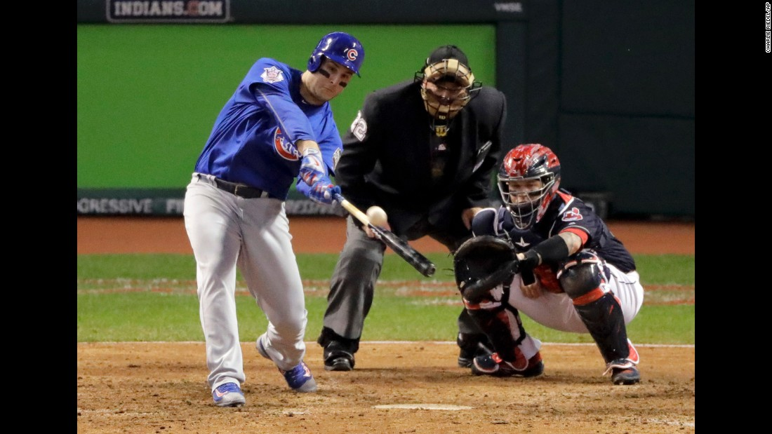 Anthony Rizzo of the Cubs hits two-run homer during the ninth inning of Game 6.
