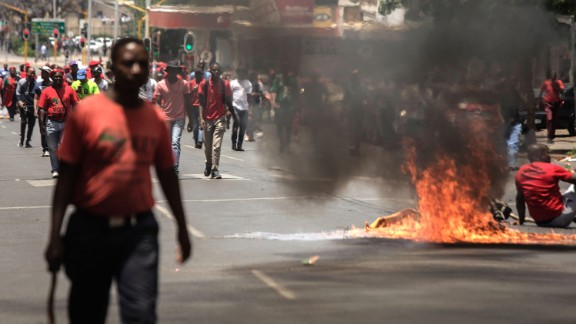 Garbage burns in the road during a demonstration in Pretoria, South Africa, on November 2.